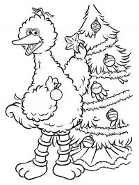 Big Bird decorates the Christmas tree